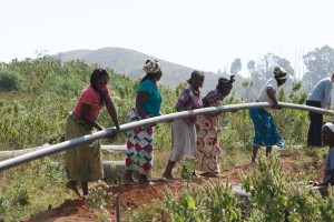 Community women install pipeline